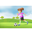 A girl playing soccer at the field vector image
