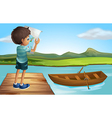 A boy at the river with a wooden boat vector image vector image