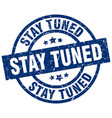stay tuned blue round grunge stamp vector image