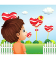 A boy watching the giant lollipops vector image vector image