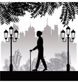 silhouette elder man walk stick park twon vector image