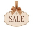 Sale banner with golden ribbon and a bow vector image