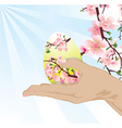 hand with Easter egg vector image