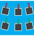 Blank photo frames on a clothesline vector image