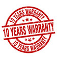 10 years warranty round red grunge stamp vector image