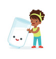 cute black little girl and funny milk glass with vector image