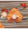 Hot steaming cup of coffee and autumn leaf vector image
