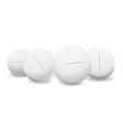 Four white pills vector image