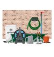 Garden Equipment In Front Of Brick Wall vector image