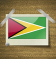 Flags Guyana at frame on a brick background vector image