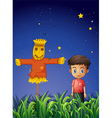 A little boy standing beside the scarecrow vector image vector image