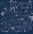 Set of decorative swirls hand-drawn on a dark vector image