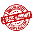 2 years warranty red grunge round vintage rubber vector image