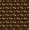 pattern with dog footprints and bones vector image