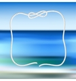 White rope frame on a blue sea blurred background vector image