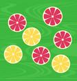 lemons and grapefruits on green wood table vector image