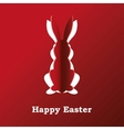 Paper rabbit on a red background vector image