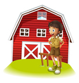 A boy standing in front of the red barnhouse vector image vector image