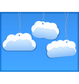 Hanging paper clouds vector image