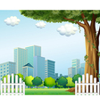A giant tree near the wooden fence across the tall vector image vector image