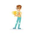 happy school boy holding winner cup kid vector image