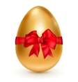 Golden egg with red bow vector image