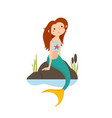 little red haired mermaid sitting on rocks vector image