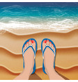 female legs in flip flops on sand beach and sea vector image