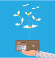 coin and dollar bill flying over hand with wallet vector image
