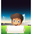 A boy at the stadium holding an empty cardboard vector image vector image