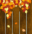 Autumn background with wooden fence and leaves vector image