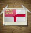 Flags Sark at frame on wooden texture vector image