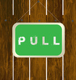 Pull sign hanging on a wooden fence vector image vector image