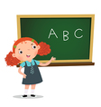 Smart girl presenting in front of blackboard vector image