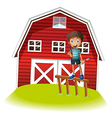 A boy standing above the fence holding an archery vector image vector image