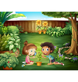 Two adorable kids studying the ladybug at the yard vector image vector image