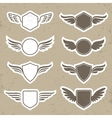 Vintage heraldic shapes with wings vector image