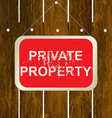 PRIVATE PROPERTY sign hanging on a wooden fence vector image