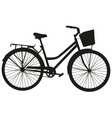 Black silhouette of a bicycle with a basket vector image vector image