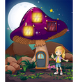 A cute girl standing beside the magical mushroom vector image
