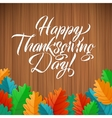 Happy Thanksgiving Day Oak Leaves on wood vector image