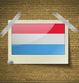 Flags Luxembourg at frame on a brick background vector image