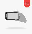 Hand holding phone for making photo icon Flat vector image