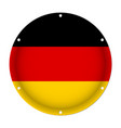 Round metallic flag of germany with screw holes vector image