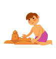 little boy making sand castle isolated on white vector image