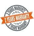 2 years warranty round orange grungy vintage vector image