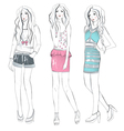 Young fashion girls in fashionable clothes posing vector image