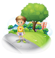 A little boy at the road across the high buildings vector image vector image