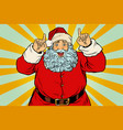 Santa claus pointing finger up vector image