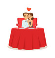 happy couple in love sitting in embrace in a cafe vector image